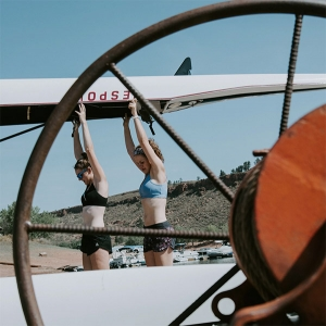 Crew members carrying boat