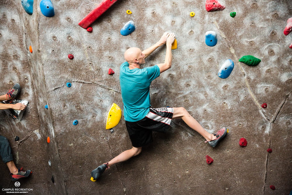 Indoor climbing participant scales the wall.