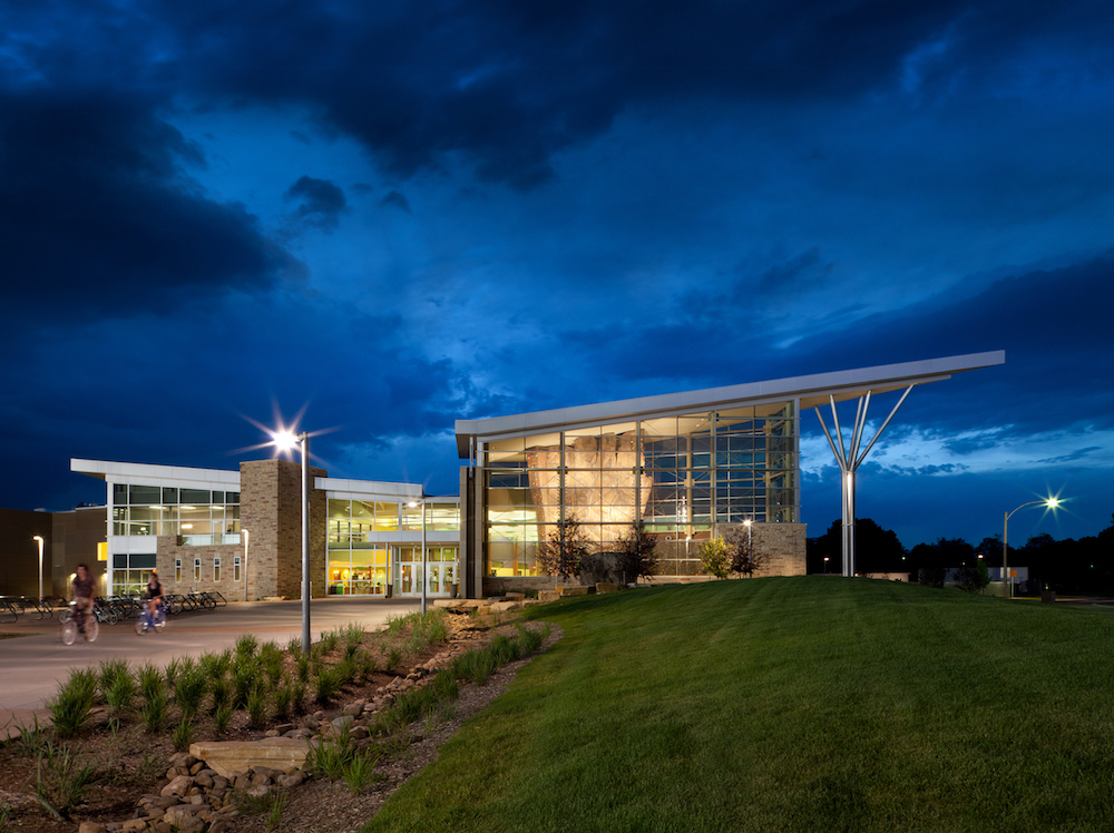 An exterior photo of the Student Recreation Center at dusk