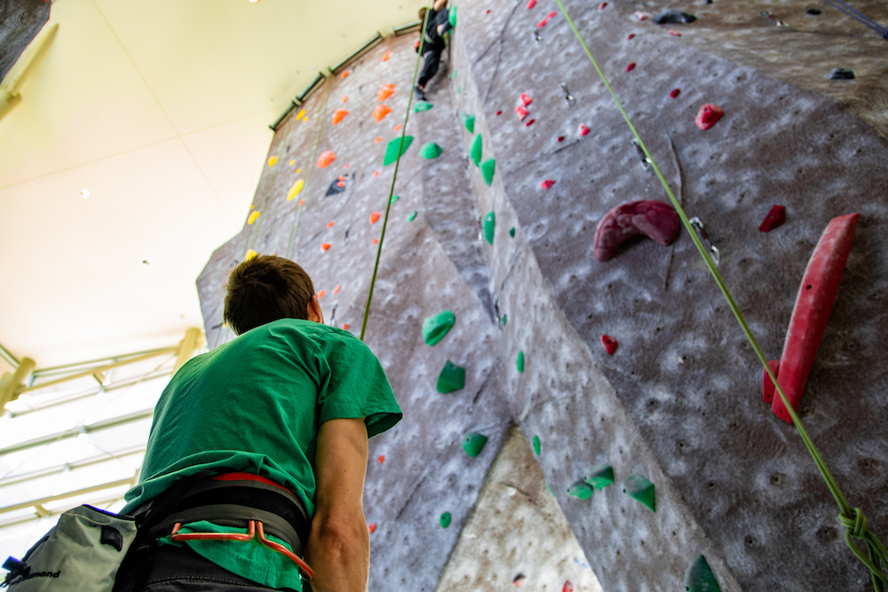 A photo of a participant looking up our climbing wall