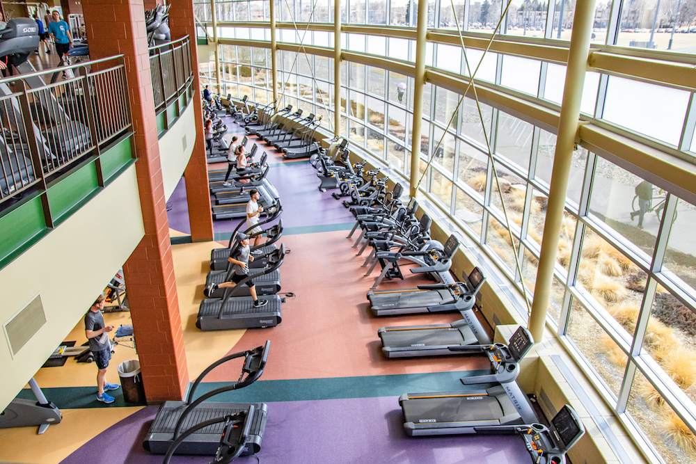 A photo of a cluster of treadmills and other workout equipment.
