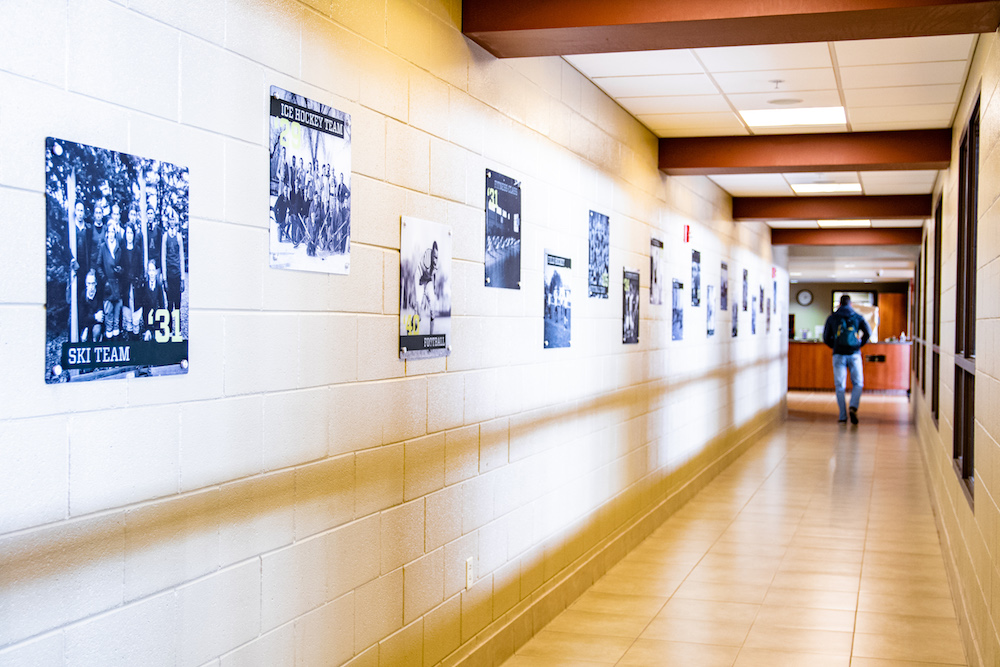 A photo of a hallway with photos of past rec sports clubs.