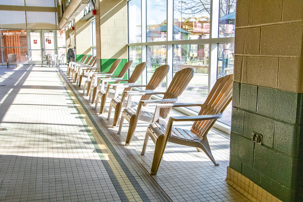 A photo of lawn chairs available for use in the pool area.