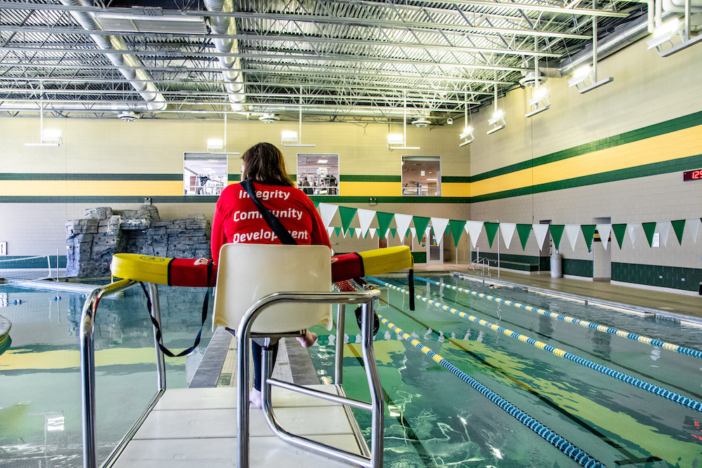 A lifeguard watching the pool areas.