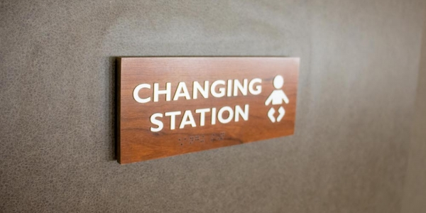 "A photo of a sign that reads ""Changing Station""."