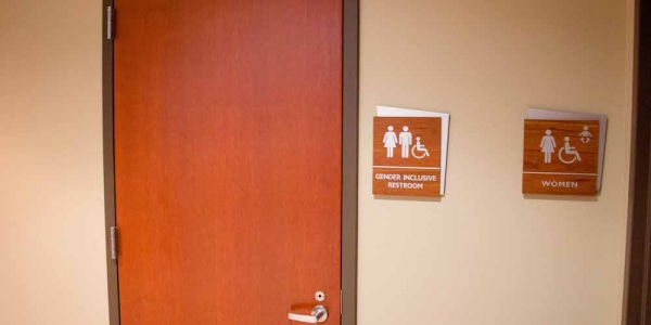 A photo of a gender inclusive restroom and women's restroom.