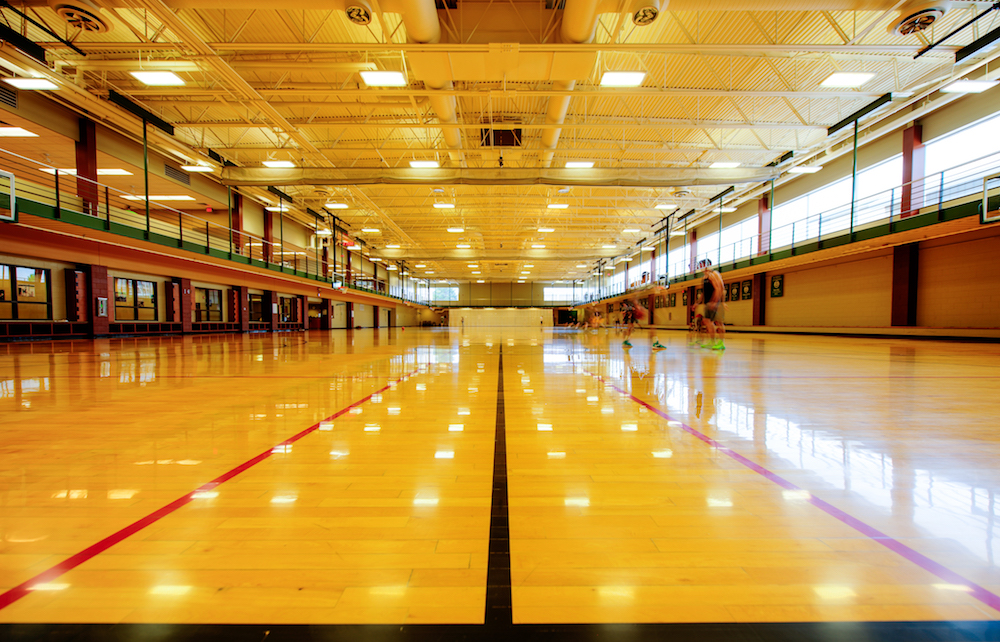 A photo of the Student Recreation Center's four-court basketball gym