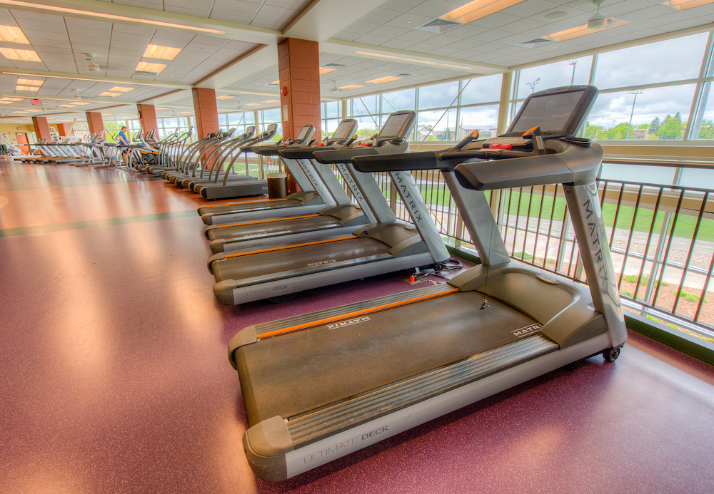 A photo of treadmills upstairs the student rec center.