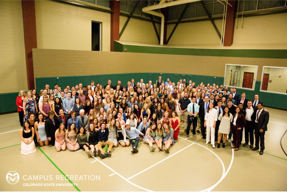 Large group photo of Rec Staff at the end of the year Recies banquet in the Mac gym.
