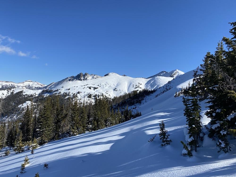 Snowy peak peeks out of the sunshine.
